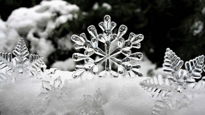 A snowy scene with giant magnified snowflakes