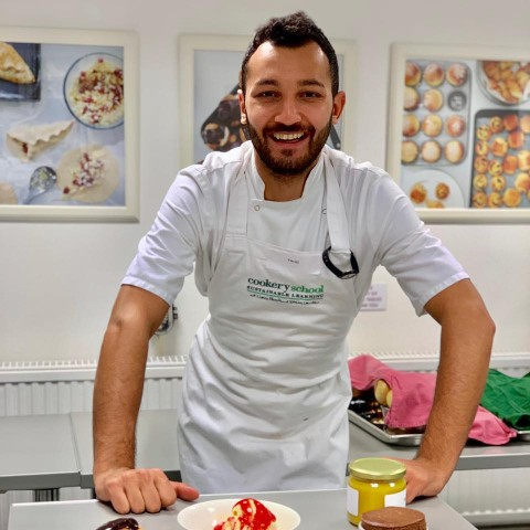 Faraj smiling in his chef's apron